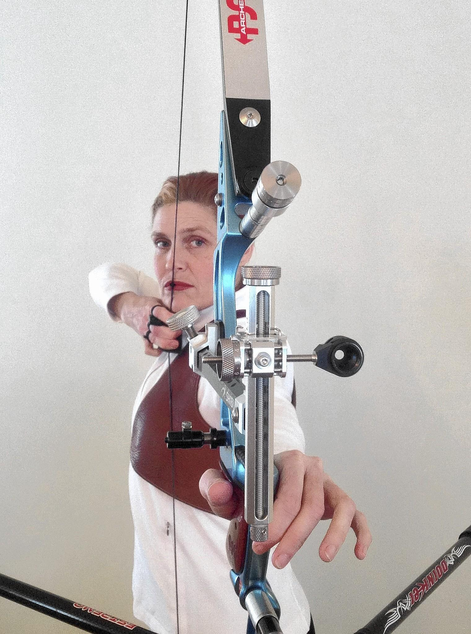 Laura Bennett Shelton takes aim with her recurve bow. The 50-year-old Bethlehem woman took up archery in August and progressed so rapidly that she is shooting for the u.S. at the World Indoor Archery Championships in France this week.