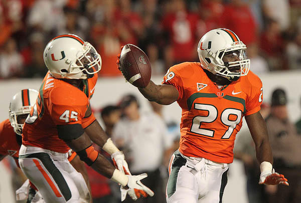 JoJo Nicolas (29) celebrates an interception in a win over Ohio State on Sept. 17, 2011 at Sun Life Stadium in Miami Gardens Florida.