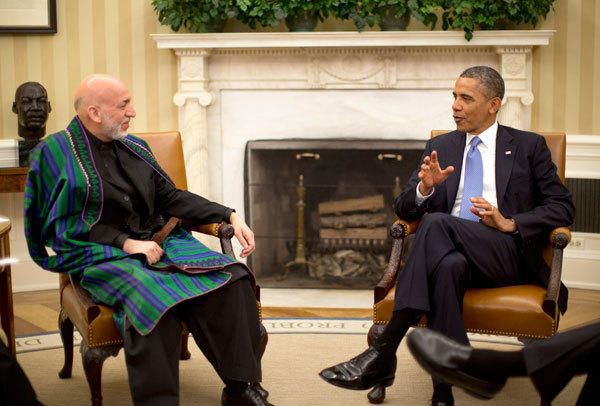 U.S. President Barack Obama meets with Afghanistan's President Hamid Karzai in the Oval Office of the White House in Washington, January 11, 2013.