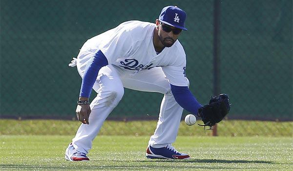 Dodgers center fielder Matt Kemp fields a ball during spring training in Glendale, Ariz., on Feb. 14.