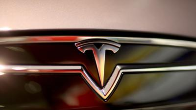 Tesla Motors shares zoom to record high on favorable reports
