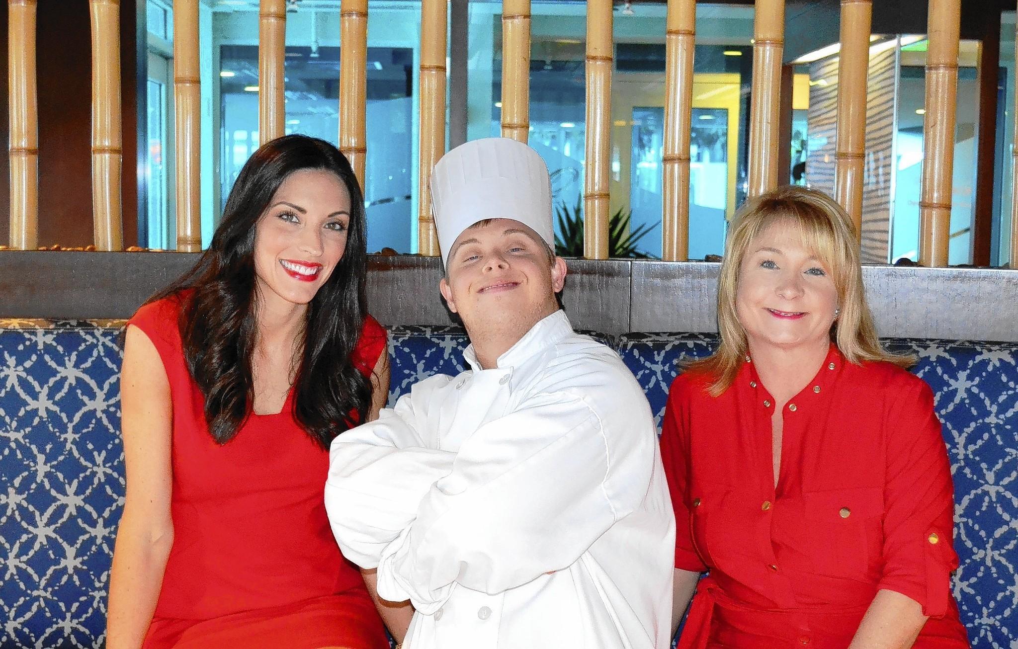 Elizabeth Crowley, left, student chef Dean Bergman and Lori Kennedy