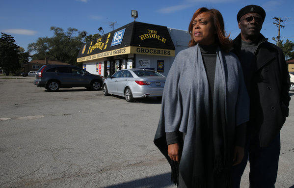 "Marsha and her ex-husband, Thomas Lee, stand outside The Huddle convenience store on Oct. 25, 2013 in Harvey where their son Thomas ""Tommy"" Lee was shot."
