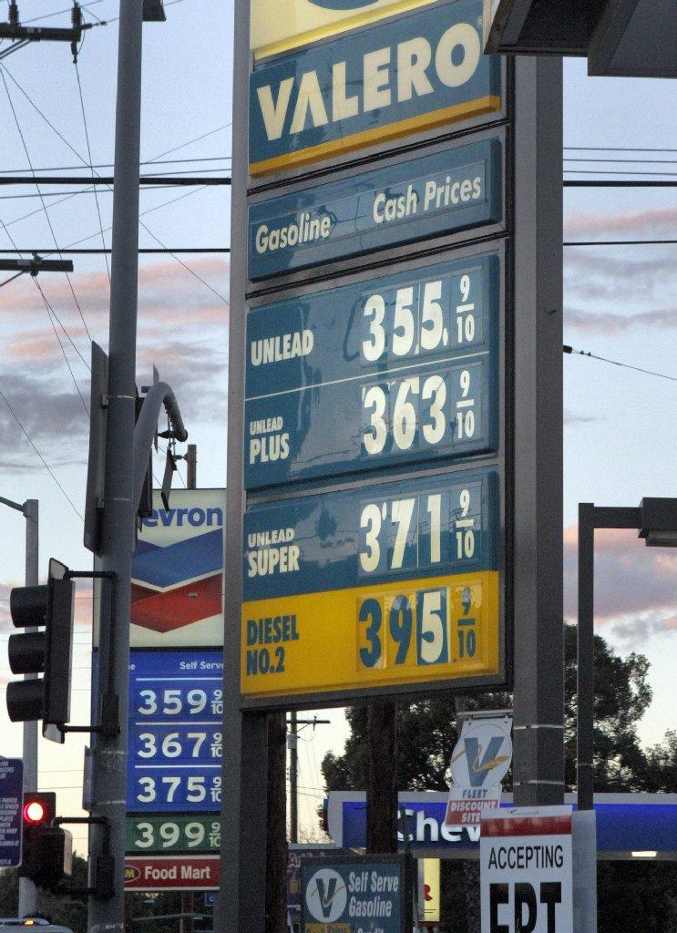 Competing gas prices at L.A.-area stations. State tax officials will adjust the gas tax down by 3.5 cents per gallon on July 1.