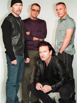 U2 (Bono, kneeling, and Edge, left, Adam Clayton and Larry Mullen in Dublin