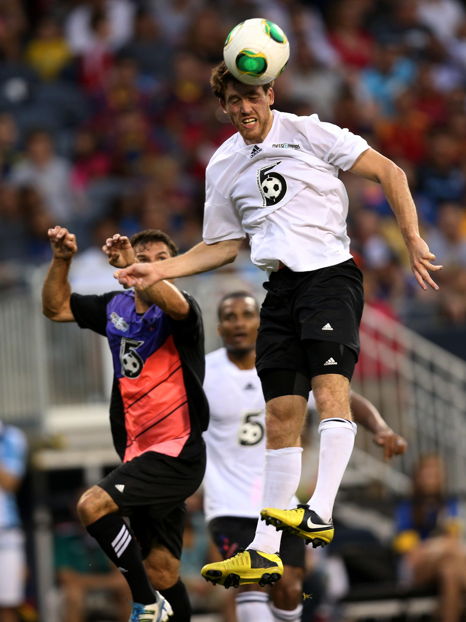 Rest of the World player Matt Eliason heads the ball during the Messi & Friends charity soccer game at Soldier Field.