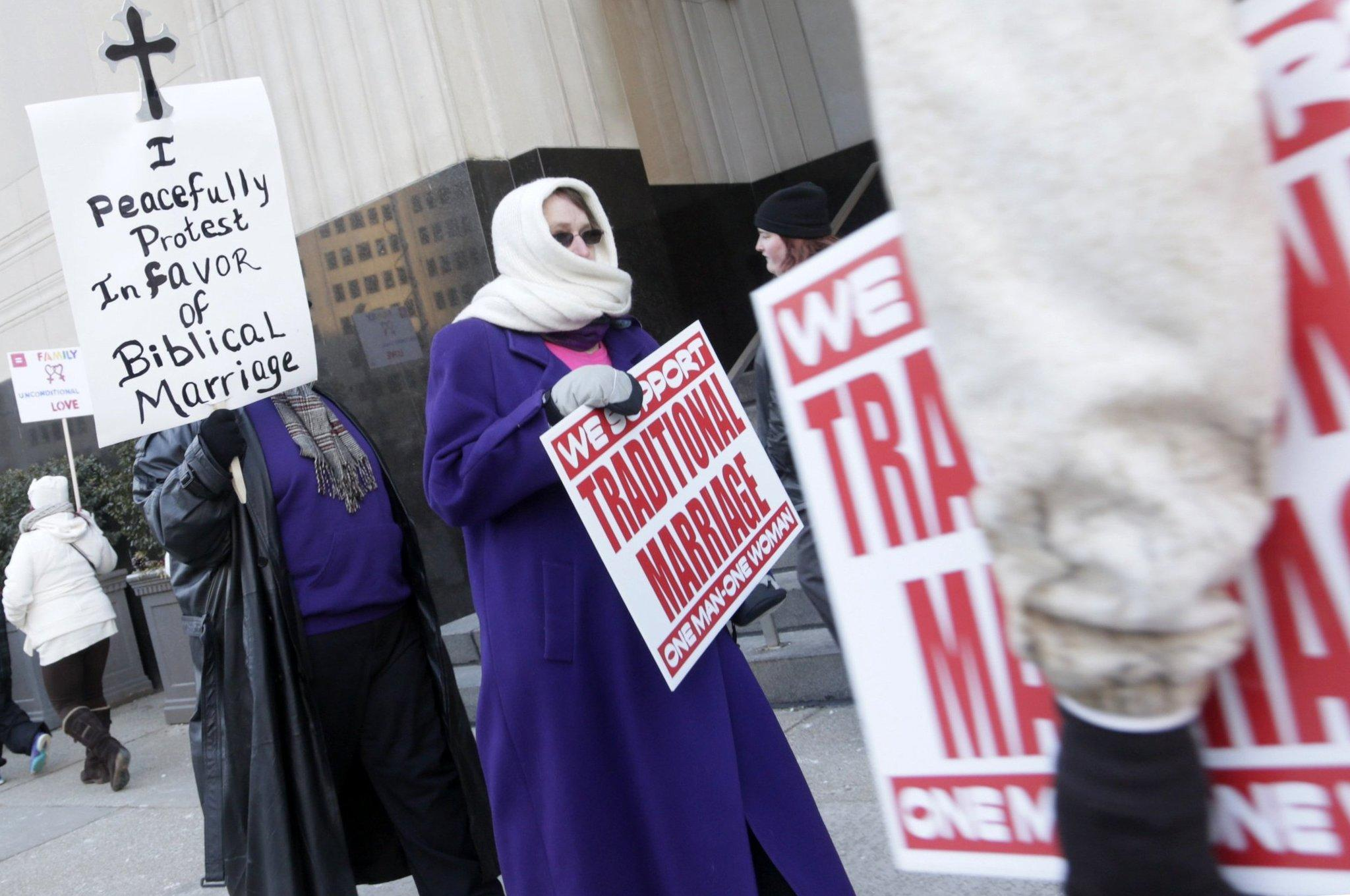 Protesters picket outside Federal Court in Detroit before a trial that could overturn Michigan's ban on gay marriage.