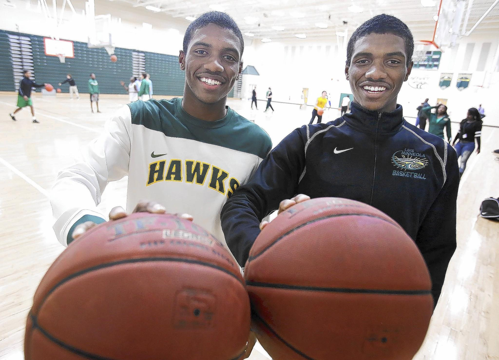 Identical twin brothers Anthony (left) and Avery Brown (right) are pictured during basketball practice at Lake Minneola High School in Minneola.