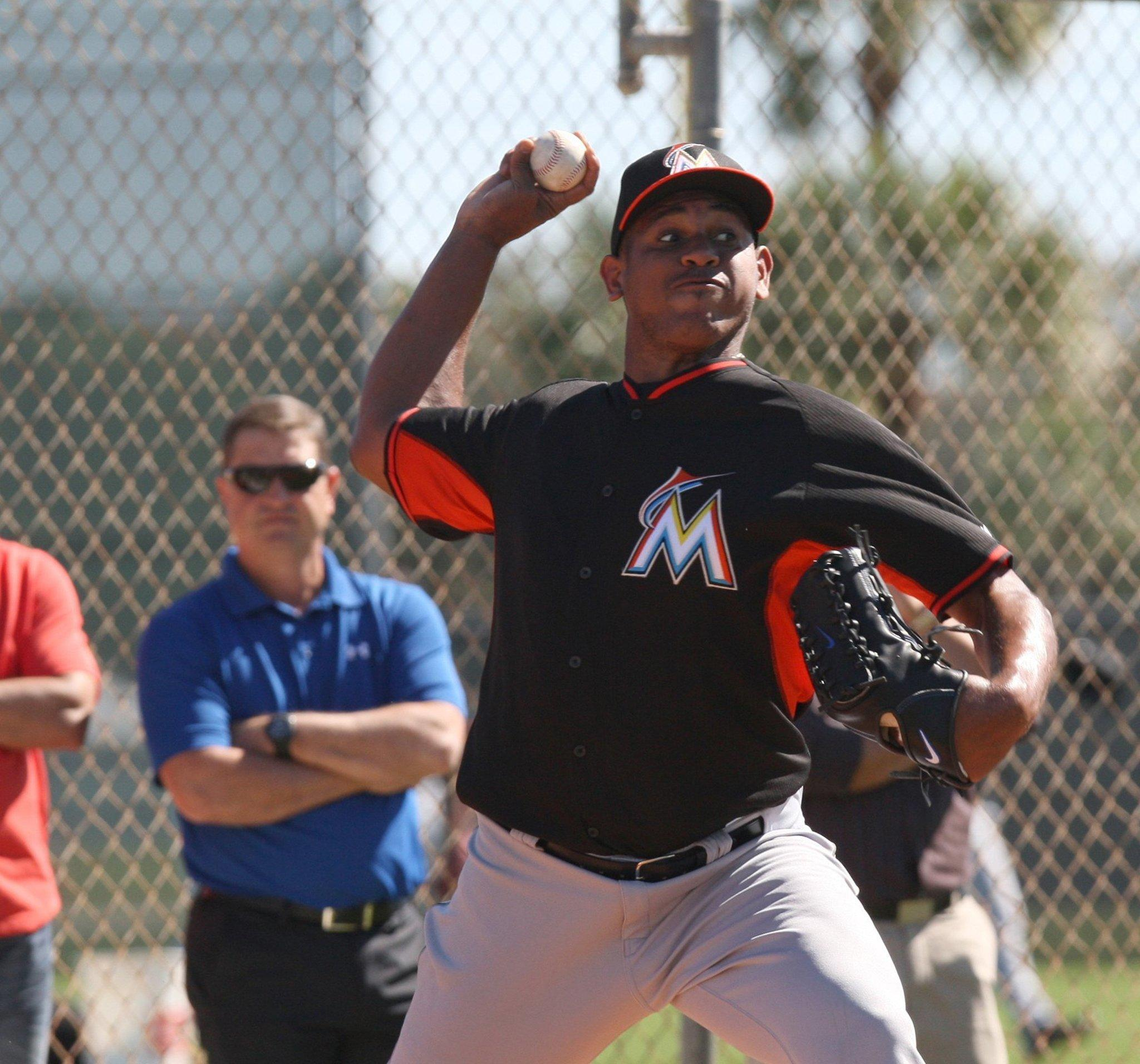Miami Marlins pitcher Carlos Marmol throws during spring training at Roger Stadium in Jupiter, Fla.