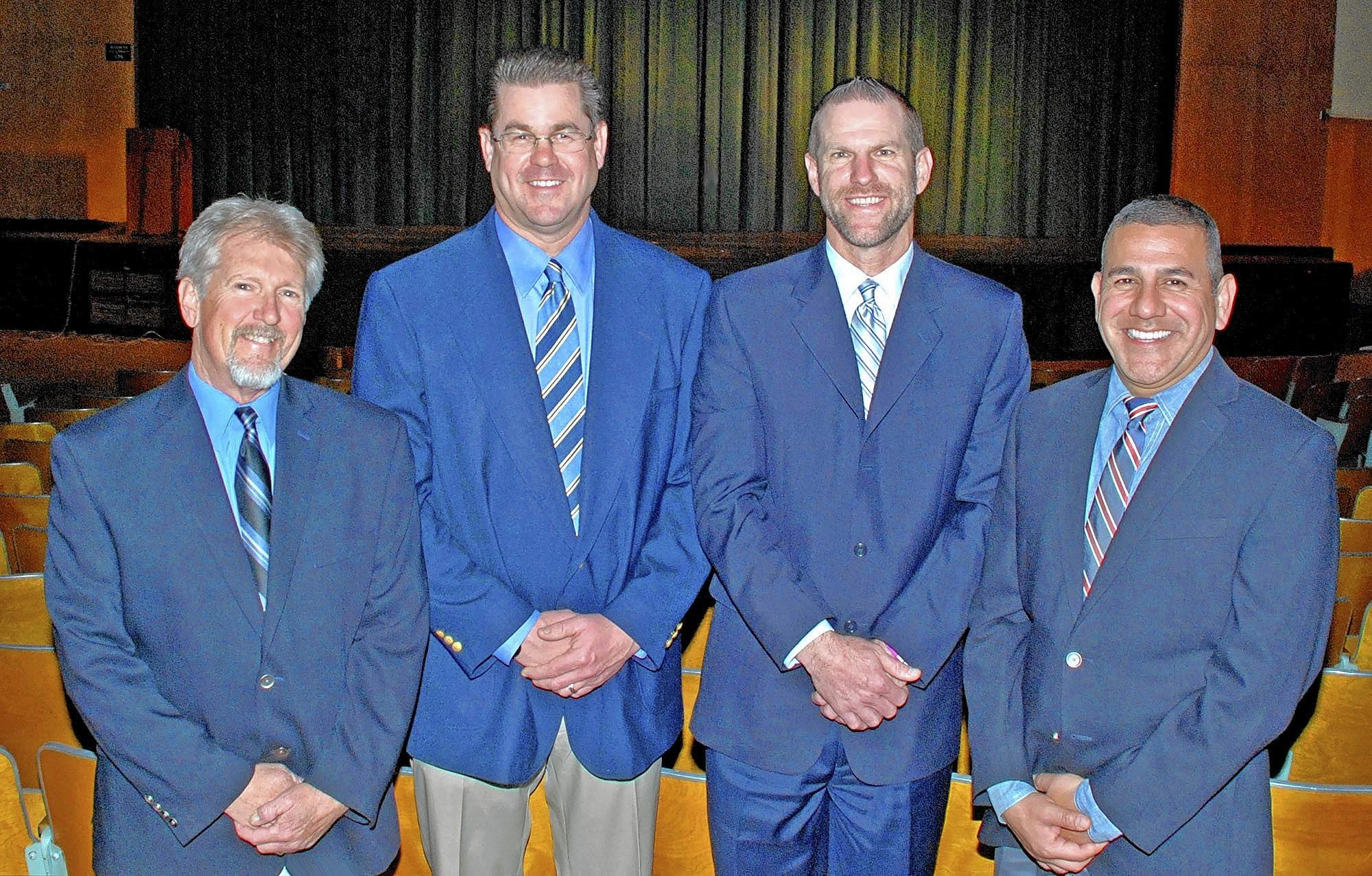 A fundraiser for the modernization of John Muir Middle School auditorium was hosted by principal Greg Miller, second from right, and his predecessors, Bruce Osgood, from left, Dan Hacking and John Paramo.