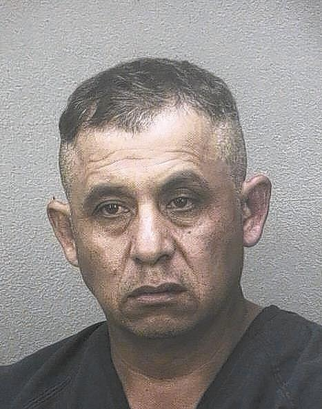 Alfonso Palomo Mendoza, 44, was arrested and accused of breaking into a neighbor's house and molesting a 14-year-old girl, Coral Springs Police said
