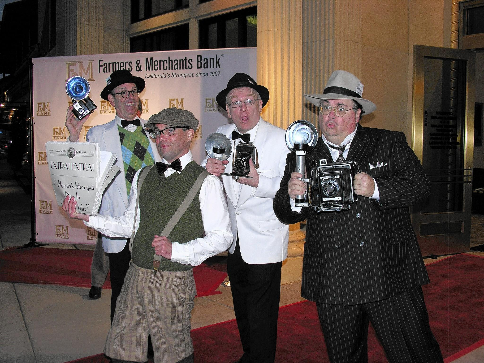 Keeping with the Roaring 20s theme, in honor of Farmers & Merchants' headquarters built in 1923, paparazzi lined the red carpet as a newsboy shouted the headline that the bank had arrived in Corona del Mar.
