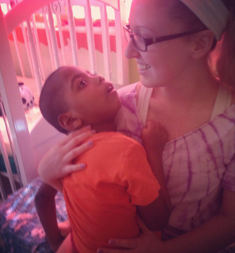 Nursing major Samantha Killmer of Amenia, N.Y. aids a disabled boy at Casa del Luz, a home for children with special needs.