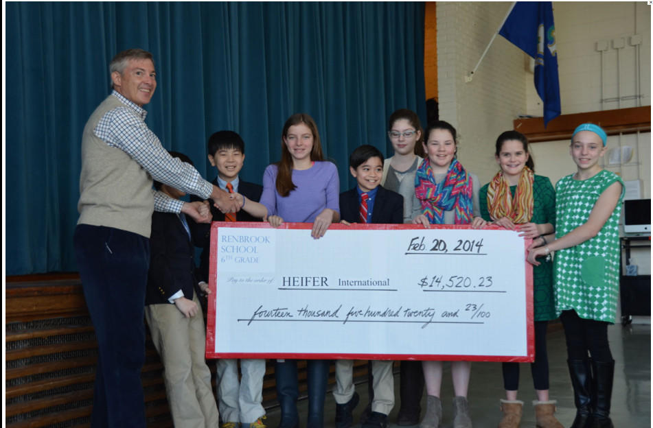 The Gift that Keeps on Giving: Renbrook students present Steve Denne with money raised to buy animals for impoverished families.