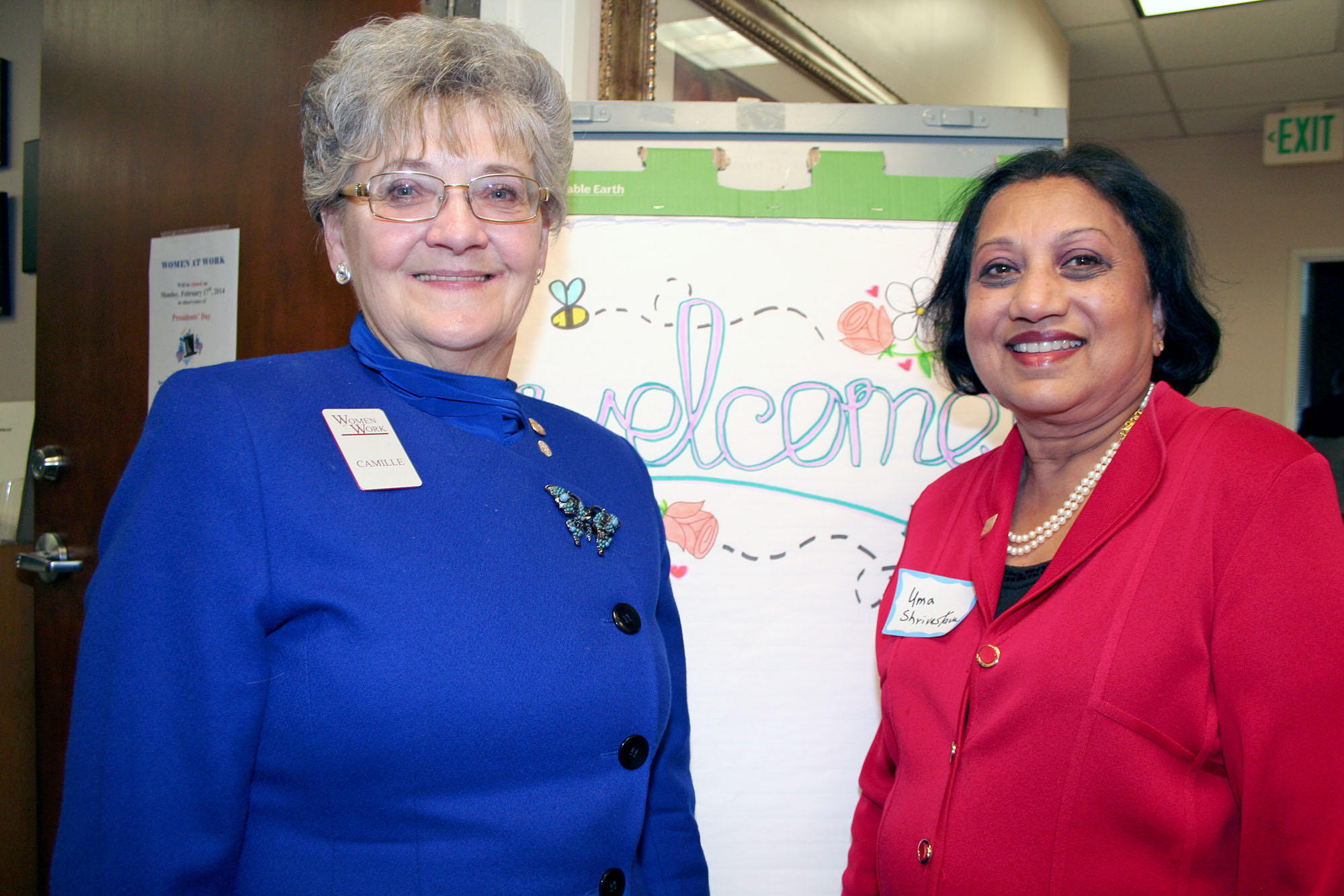 Welcoming supporters to a reception are, from left, new Women at Work Executive Director Camille Levee and Board President Uma Shrivastava.