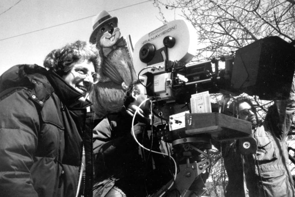 """Director Harold Ramis works on the Woodstock, Ill. location of """"Groundhog Day,"""" in 1993."""