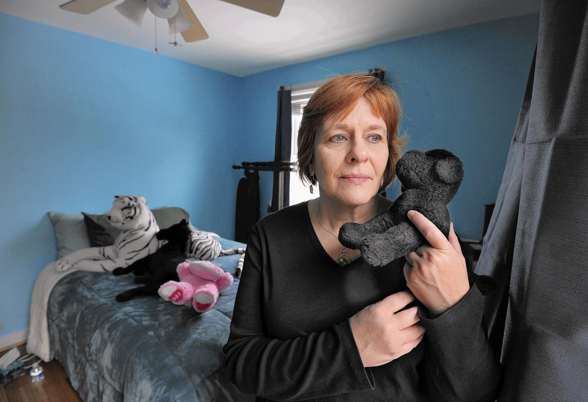 Judge to choose adult or juvenile court in howard murder cindi arnold mother of morgan lane arnold holds her daughters stuffed animal publicscrutiny Choice Image