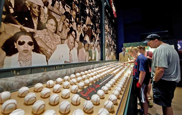 Ed and Sheri Curtin and their two sons Eddie, 12, and Austin, 10, tour the Negro Leagues Baseball Museum in Kansas City, Mo.