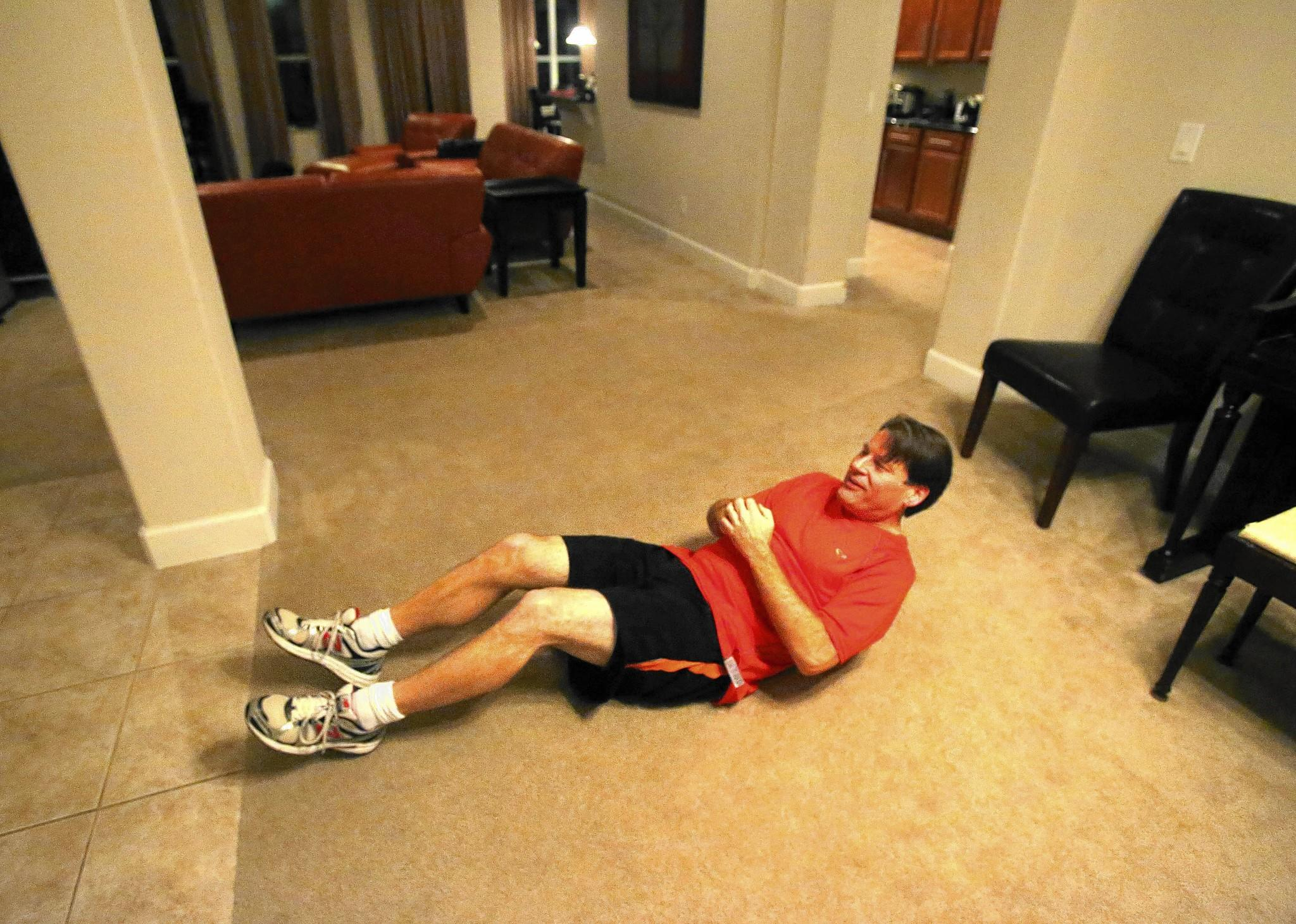 Kevin Wertman still does traditional exercises in his house to aid his weight loss.