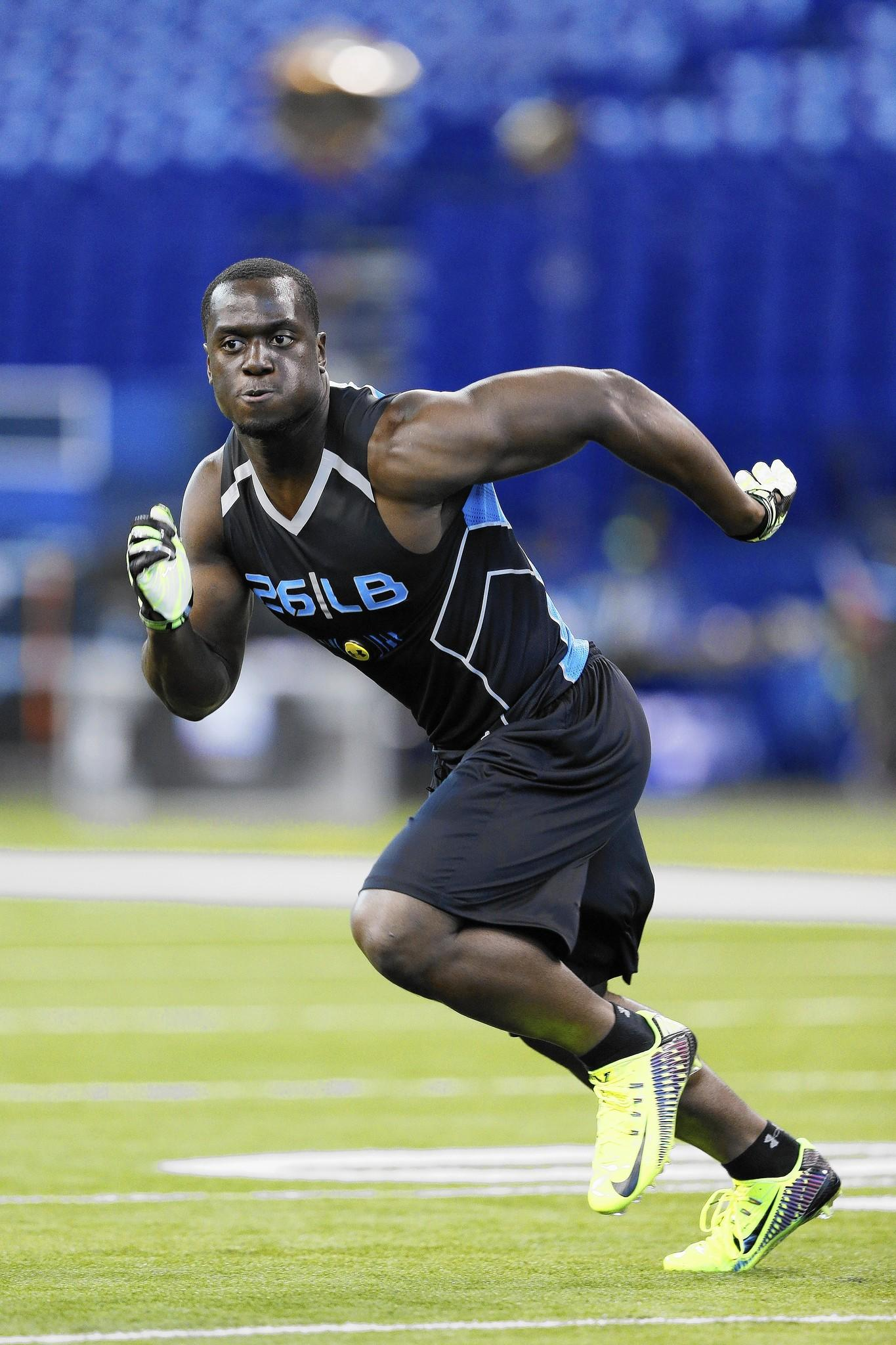 Former Notre Dame linebacker Prince Shembo takes part in the 2014 NFL Combine on Monday in Indianapolis. Over the weekend, he said he was the player accused of a sexual attack in 2010. The accuser killed herself days after making the report.