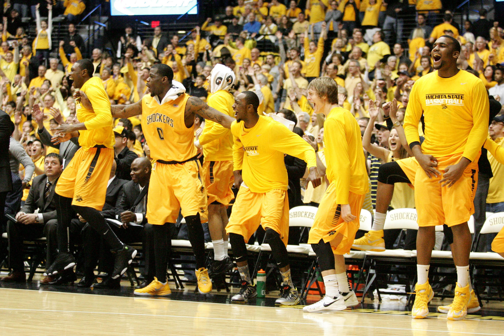 Wichita State players celebrate a basket late in a 83-54 win against Drake.
