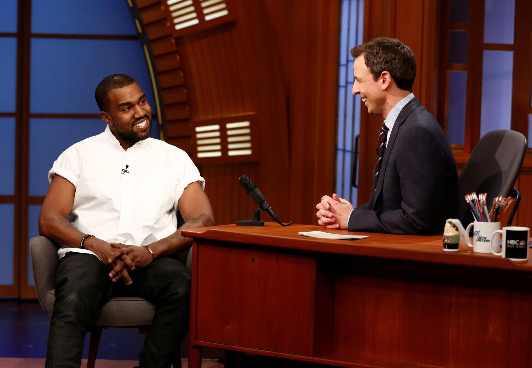 "Seth Meyers (right) interviews rapper Kanye West (left) during NBC's ""Late Night with Seth Meyers"" Feb. 25, 2014."