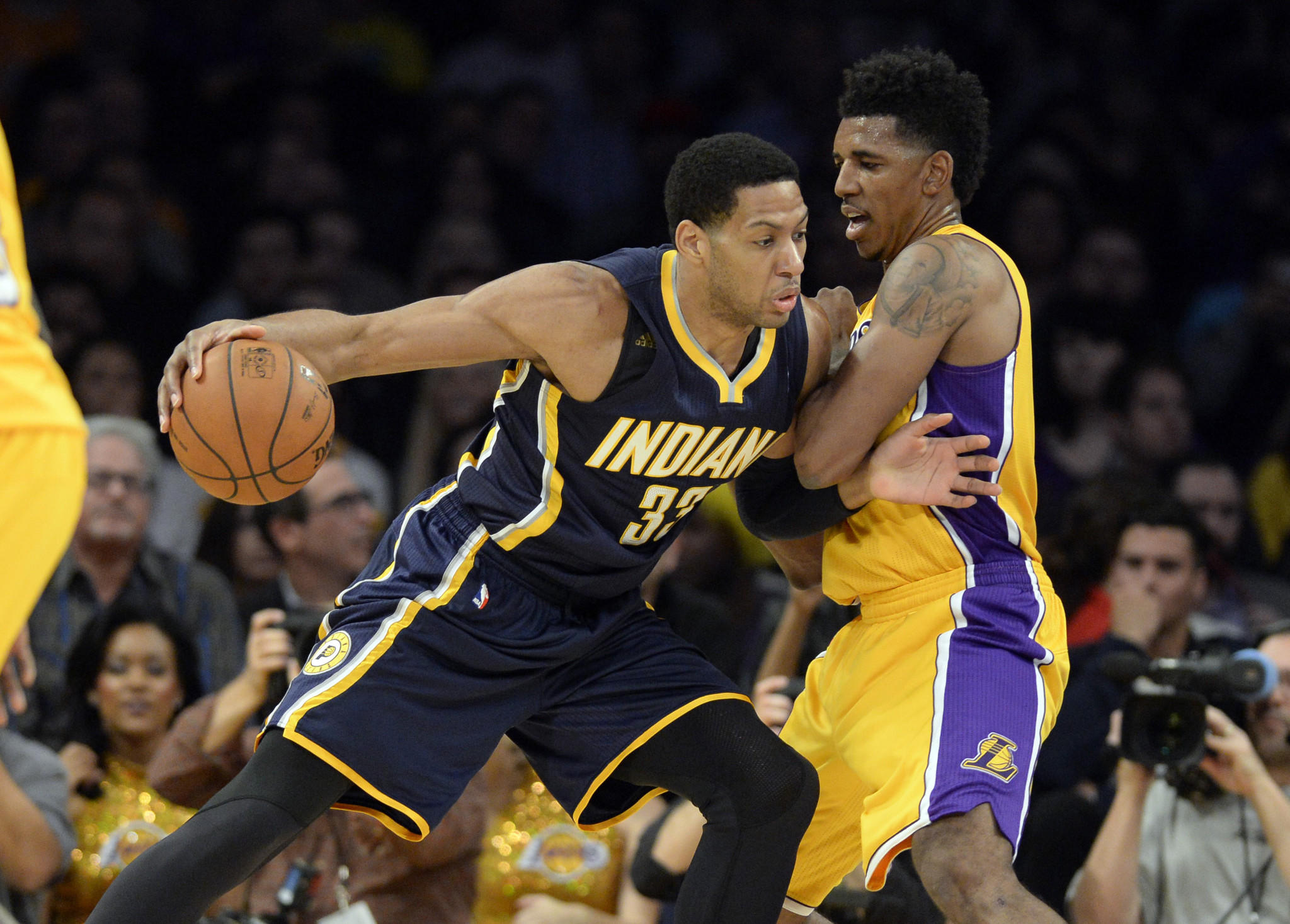 Lakers small forward Nick Young defends against small forward Danny Granger, then with the Pacers.