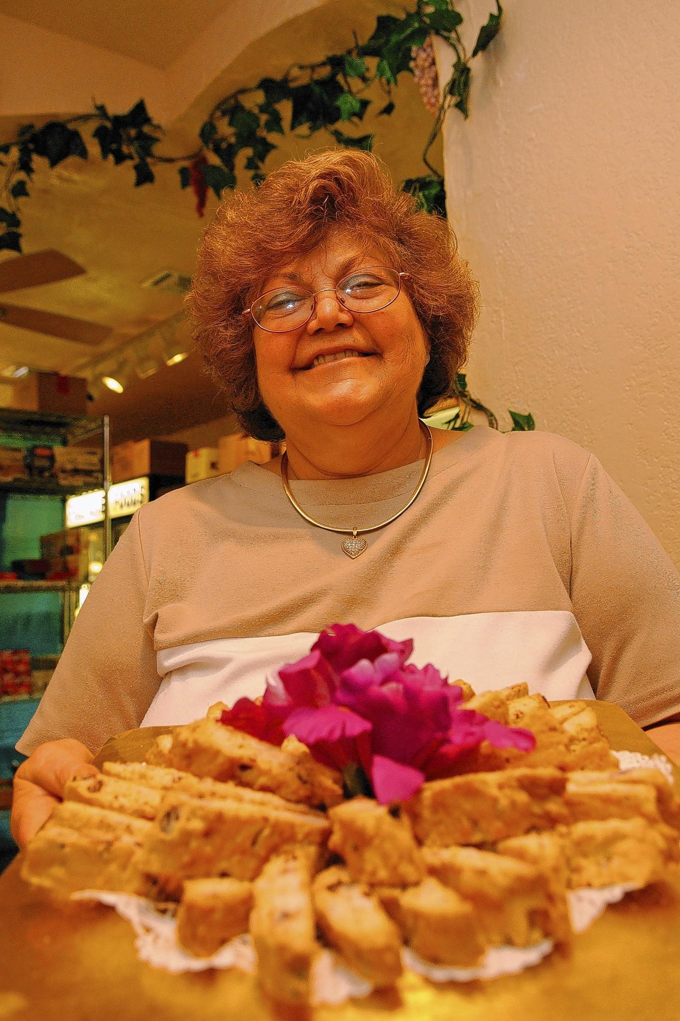 Amira Cohen holds a tray of Passover mandel bread at her deli in 2006.