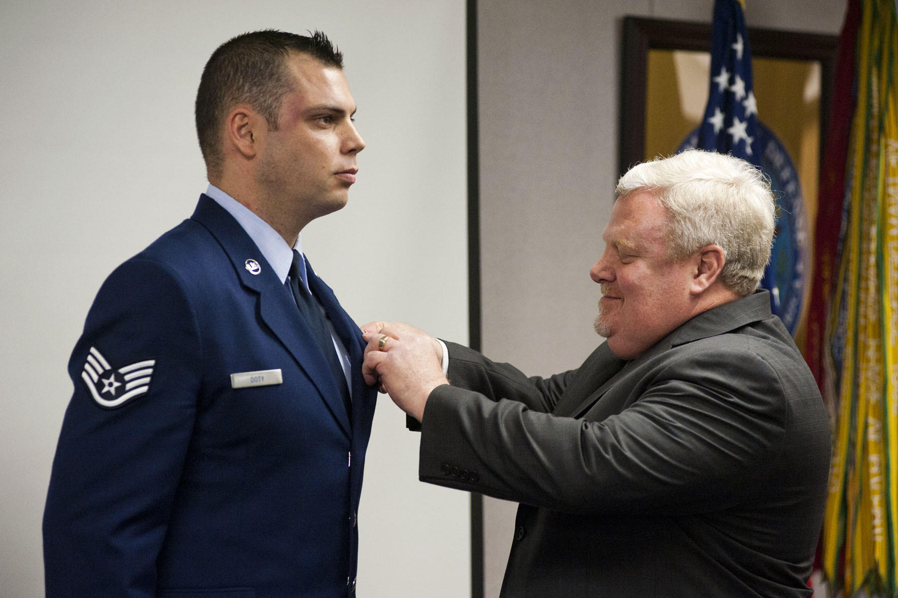 Staff Sgt. Steven Doty is presented with the Soldiers Medal by his father, Ret. Lt. Col. Timothy Doty during a ceremony on Friday, February 21.