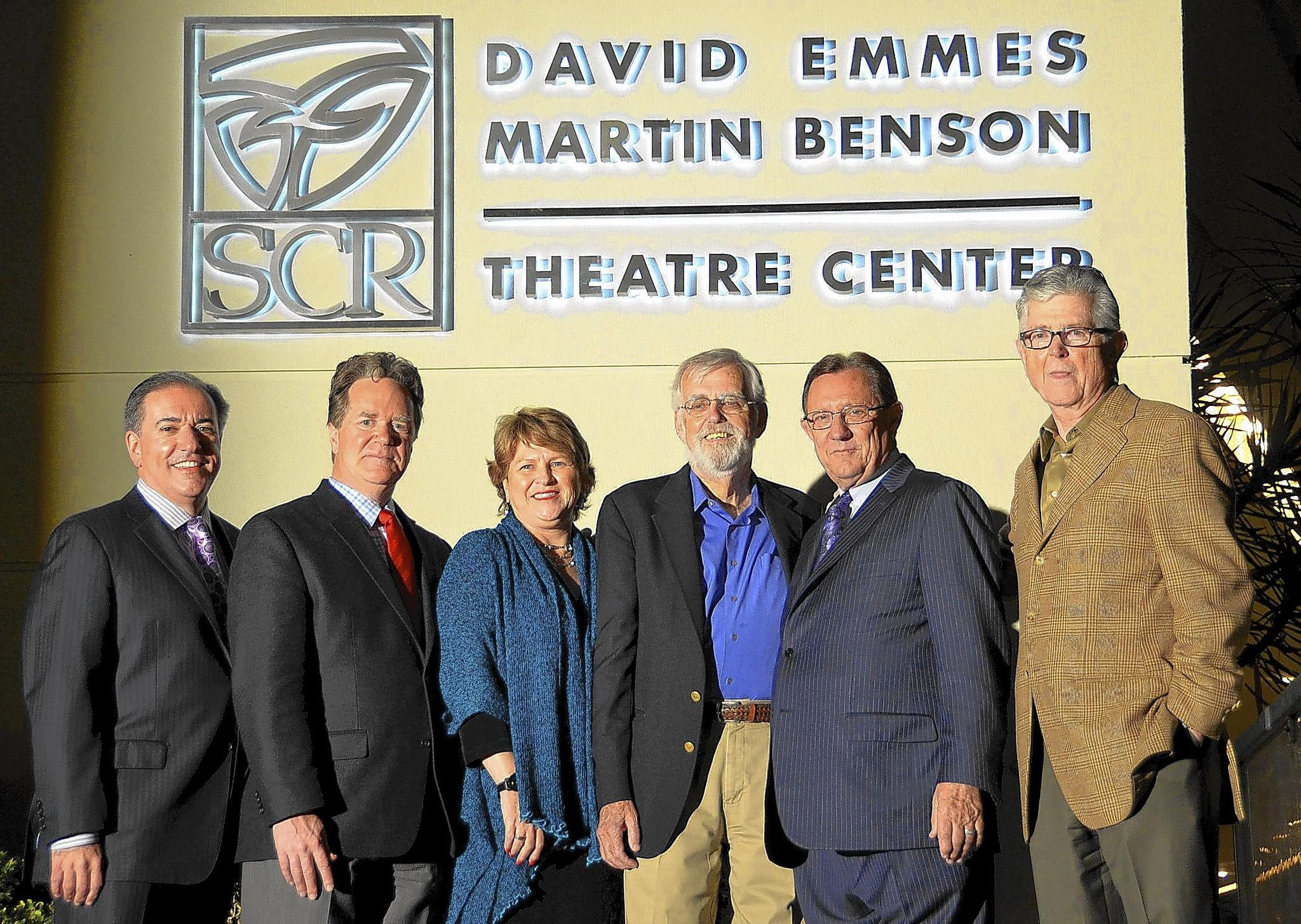 Damien Jordan, president SCR Board of Trustees; Artistic Director Marc Masterson; Managing Director Paula Tomei; honoree Martin Benson, Trustee Paul Folino; and honoree David Emmes pause for a photo under the new marquee sign during a renaming ceremony at South Coast Reperetory in Costa Mesa.