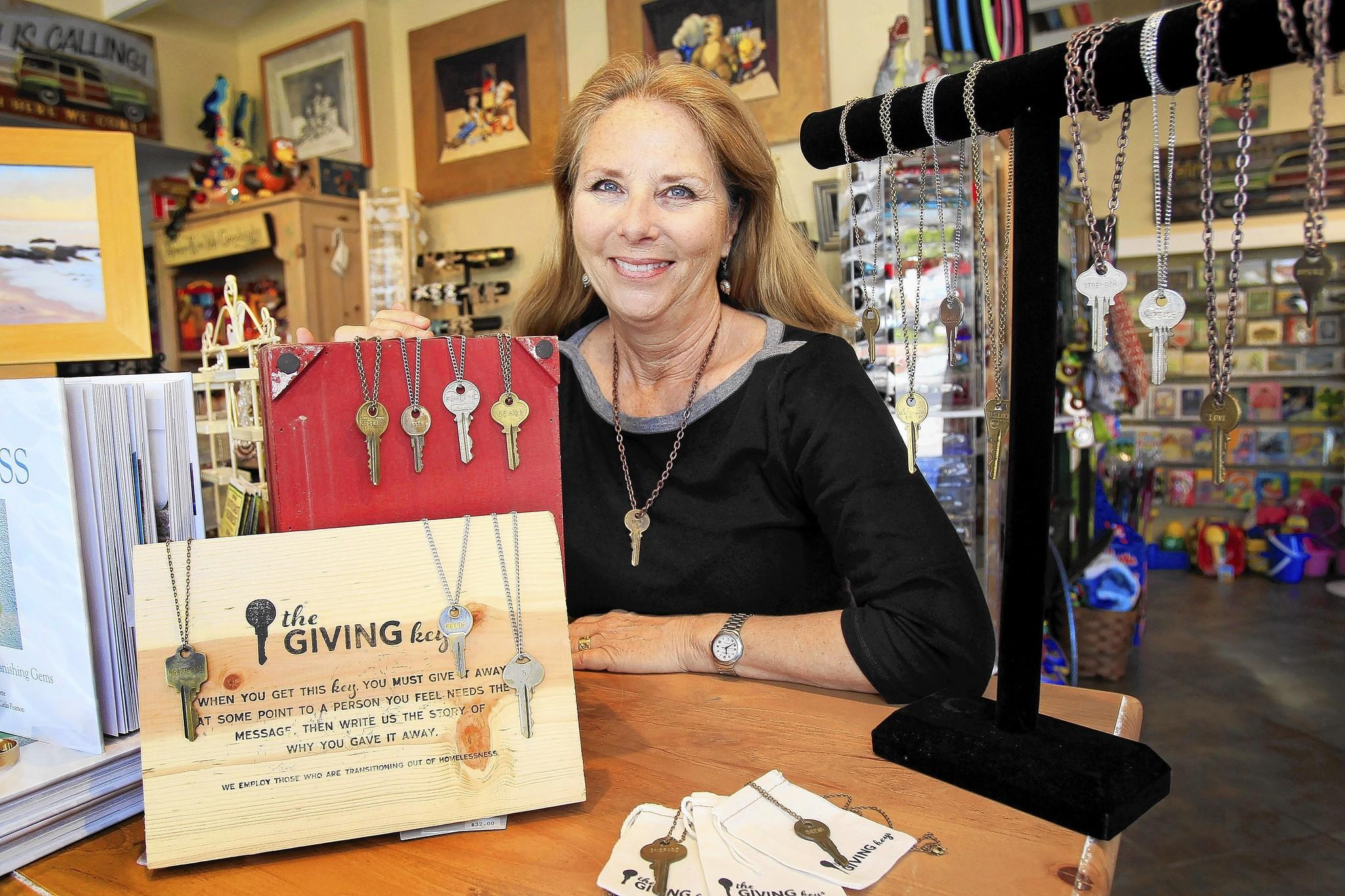 Owner Carol Robinson poses for a portrait at her Jasmine Street General Store in Laguna Beach. Jasmine Street General Store sells The Giving Keys, which hires people who are transitioning out of homelessness and trains them to create jewelry from repurposed keys. The Giving Keys is a Los Angeles-based company represented at retailers across the country.