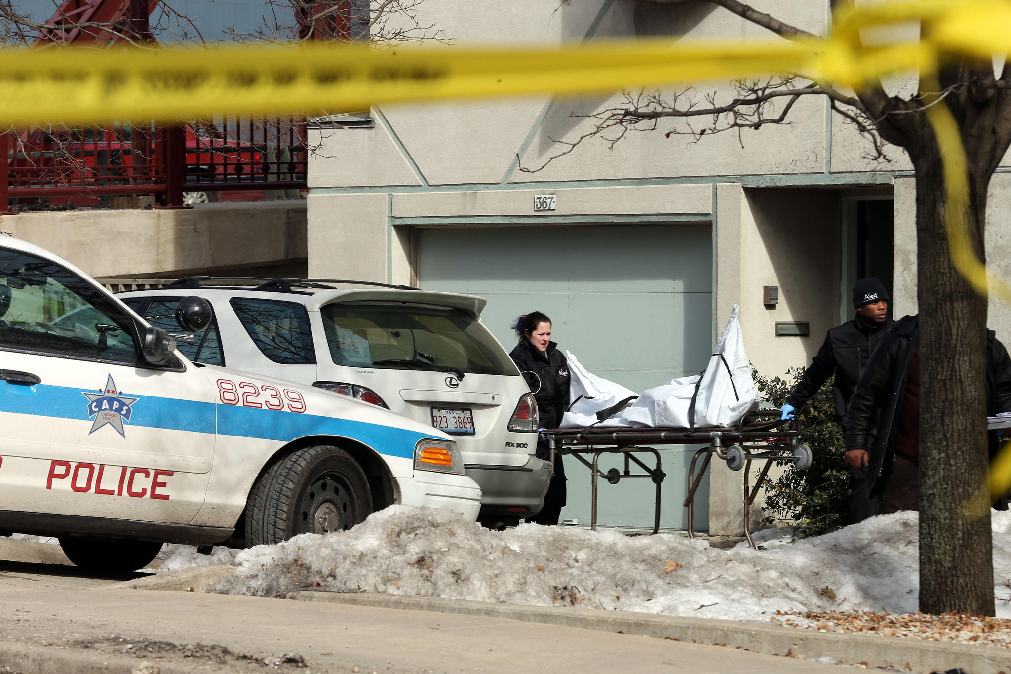 The body of a man found after a fire was extinguished is removed from a townhome in the 300 block of North Canal Street.