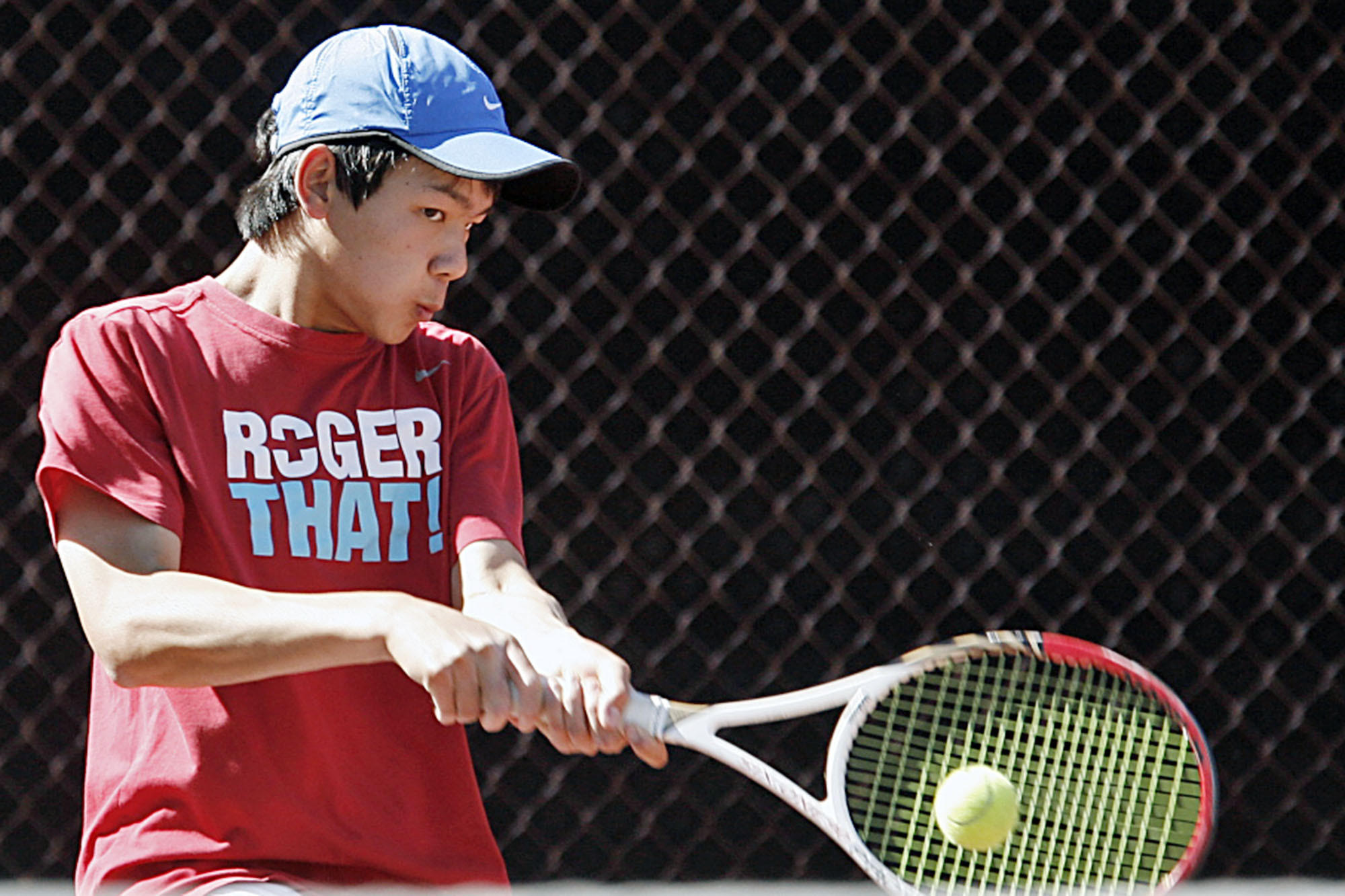 La Cañada's Ryan Lee swings at the ball during a match against San Marino's Daniel Gealer at La Cañada High School on Wednesday, April 17, 2013.