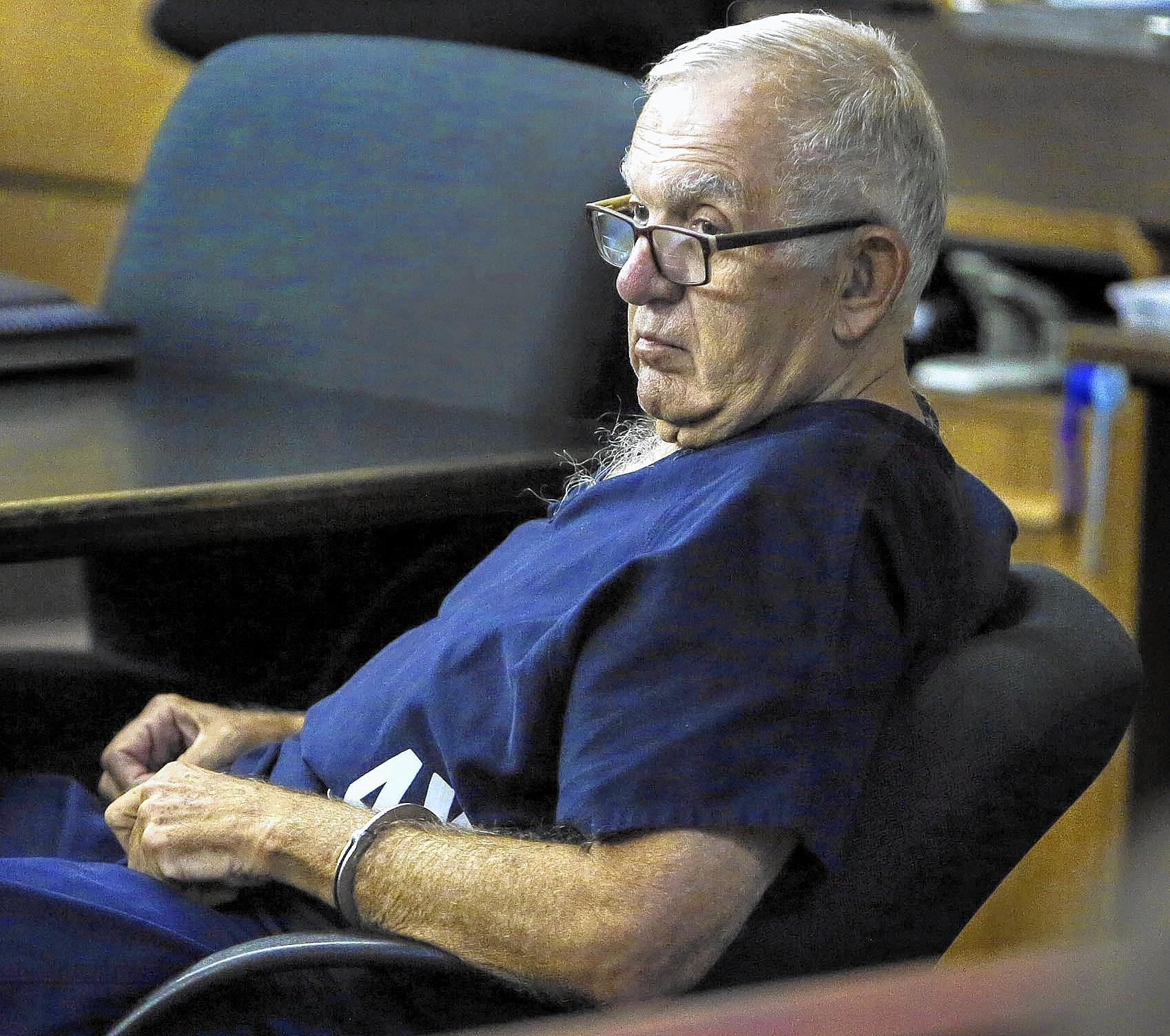 Dennis DeMartin sits in court Tuesday morning, January 28, 2014, where he was sentenced to four months in jail and nearly two months on house arrest for his actions as a juror in polo mogul John Goodman'