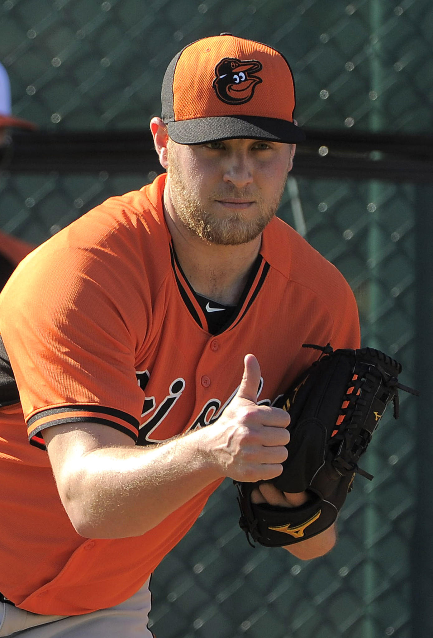 Baltimore Orioles pitcher Evan Meek gestures between throws during workouts at the Orioles' spring training facility.