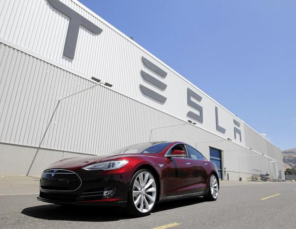 A Tesla Model S electric vehicle is parked outside the Tesla factory in Fremont, Calif.