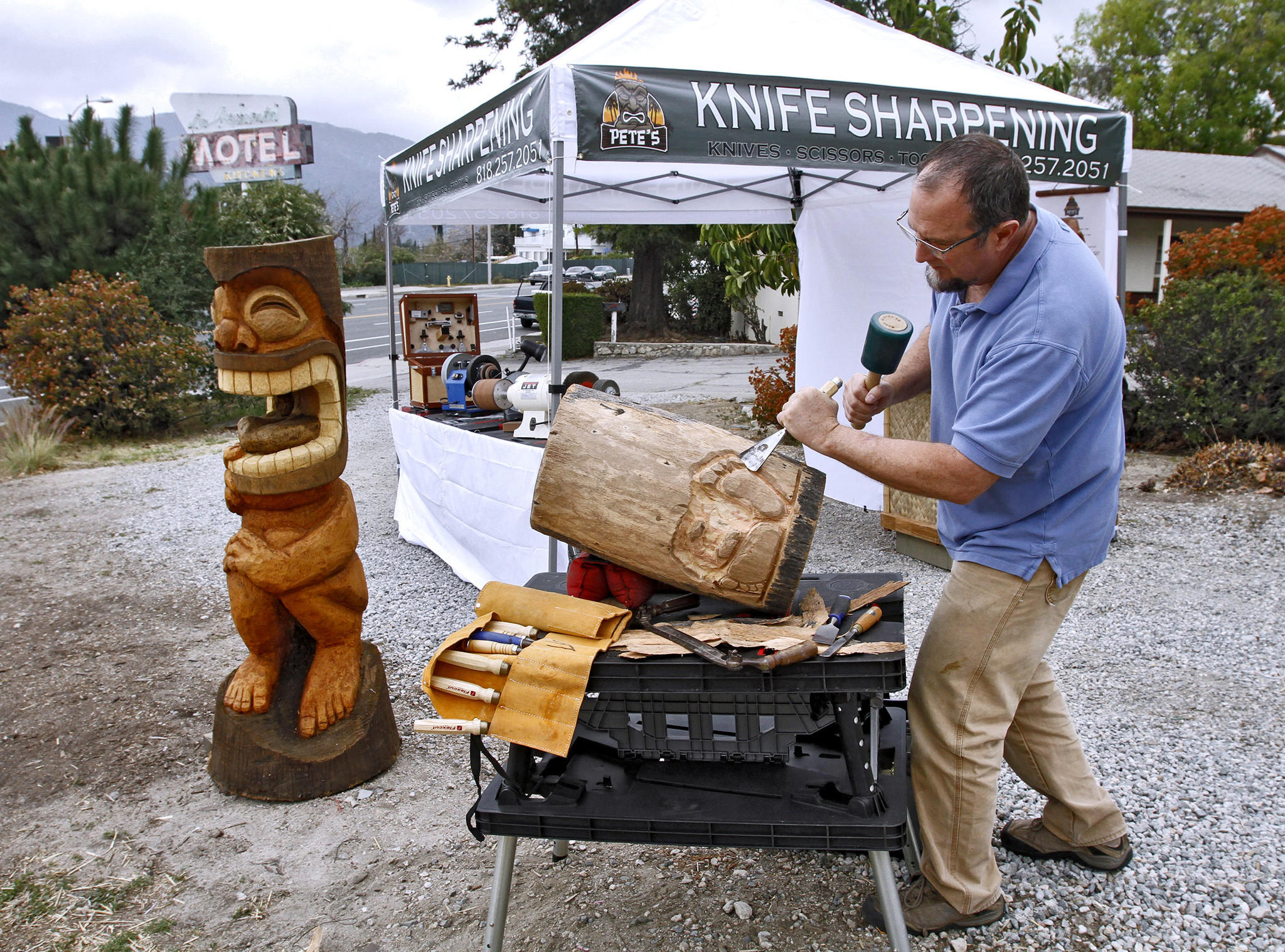 When no customers are around, Peter Gick carves out some tikis at his knife sharpening stand on Foothill Blvd. at Briggs Ave. in his home town of La Crescenta on Wednesday, Feb. 26, 2014. Gick also has his stand at the Glendale Farmer's Market on Thursdays.
