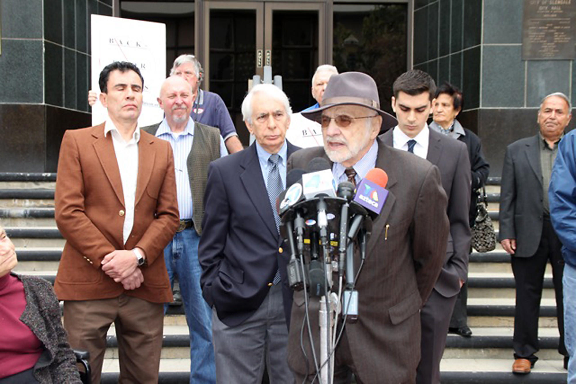 Harry Zavos, a board member of the Glendale Coalition for Better Government, the organization that is suing the city over money transfers, speaks out at a Wednesday press conference.