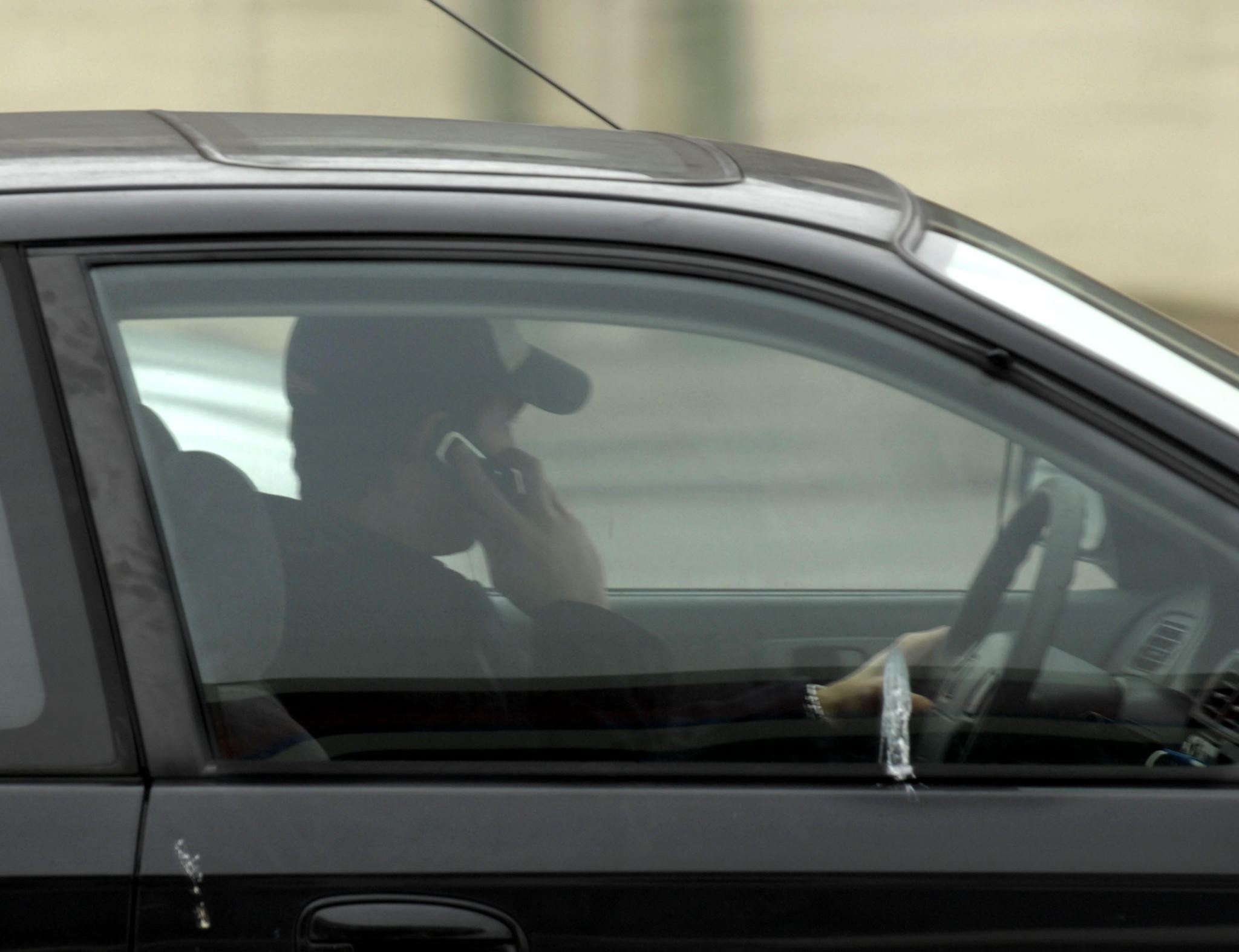 Drivers are already prohibited from using hand-held cell phones, but the new law lets police stop them for that offense alone.