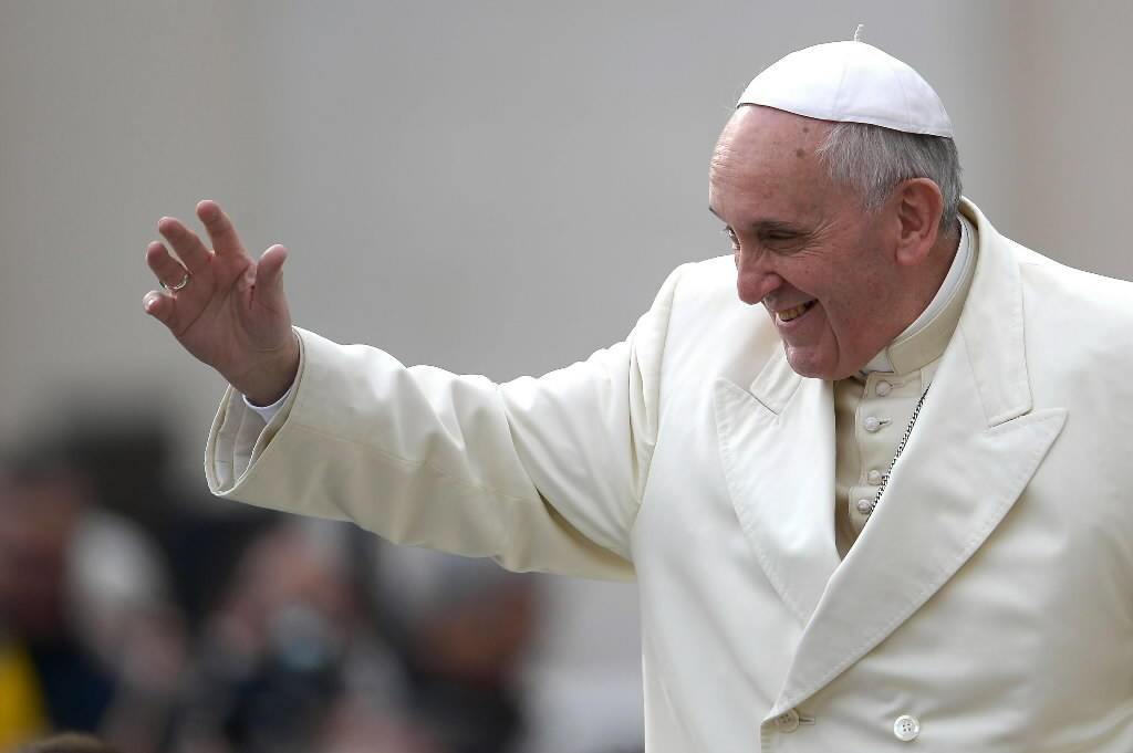 Pope Francis waves as he arrives for his general audience in St Peter's square at the Vatican on Feb. 26.