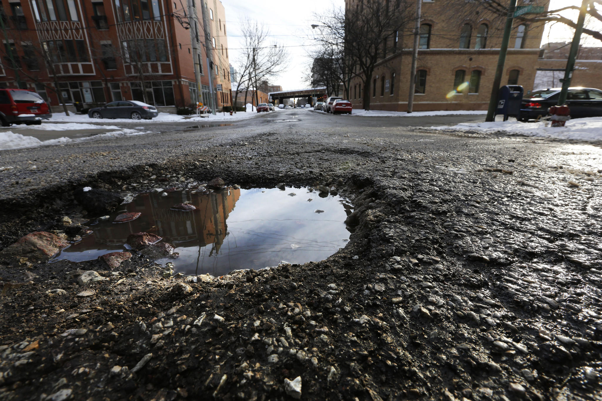 A pothole in the middle of the 700 block of N. Greet Street in Chicago (looking south) on Sunday, Jan. 26, 2014.