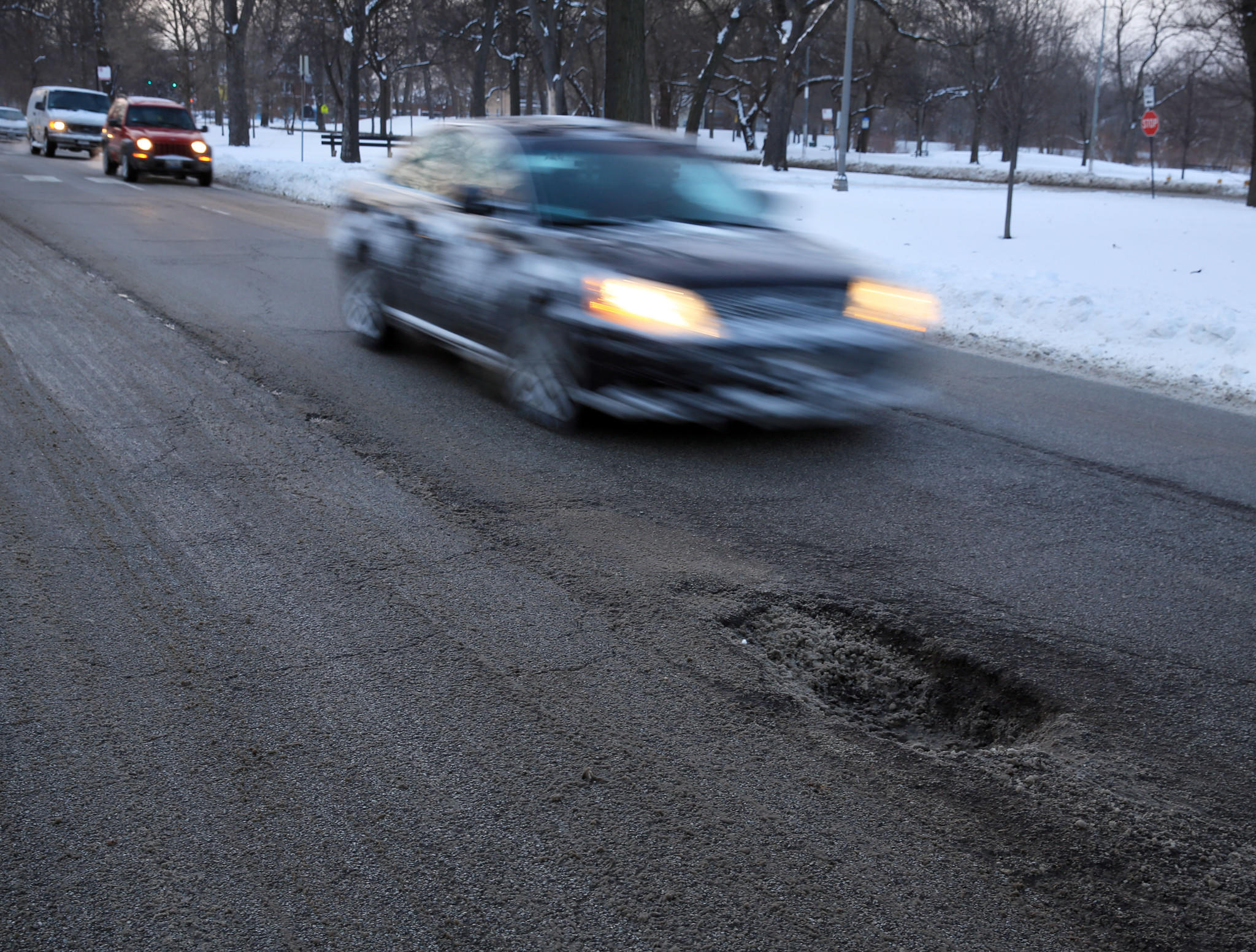 West Garfield Boulevard in Chicago is practically an obstacle course of potholes, including this crater near Elizabeth Street seen on Monday, Jan. 6, 2014.
