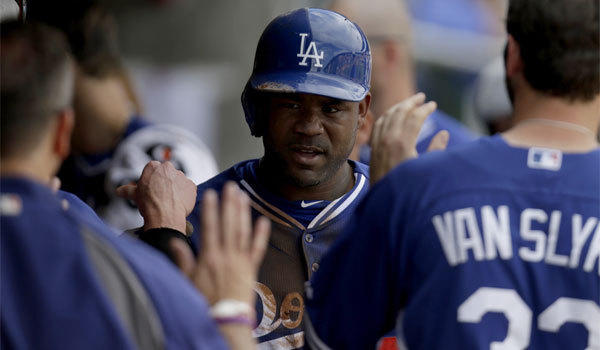 Carl Crawford is congratulated in the dugout after scoring the Dodgers' only run in a 4-1 loss to the Arizona Diamondbacks on Wednesday in Scottsdale, Ariz. Crawford said he felt tightness in his leg after scoring from first base on Yasiel Puig's double and was not in the lineup on Thursday.