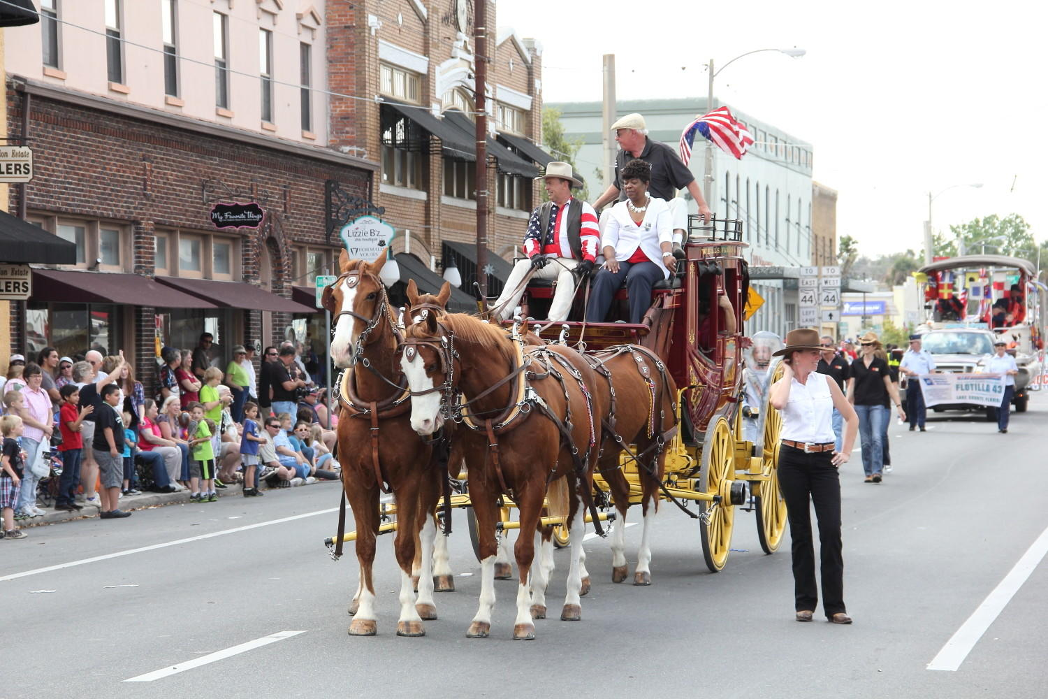 A stagecoach takes part in the 2013 Georgefest parade in Eustis.