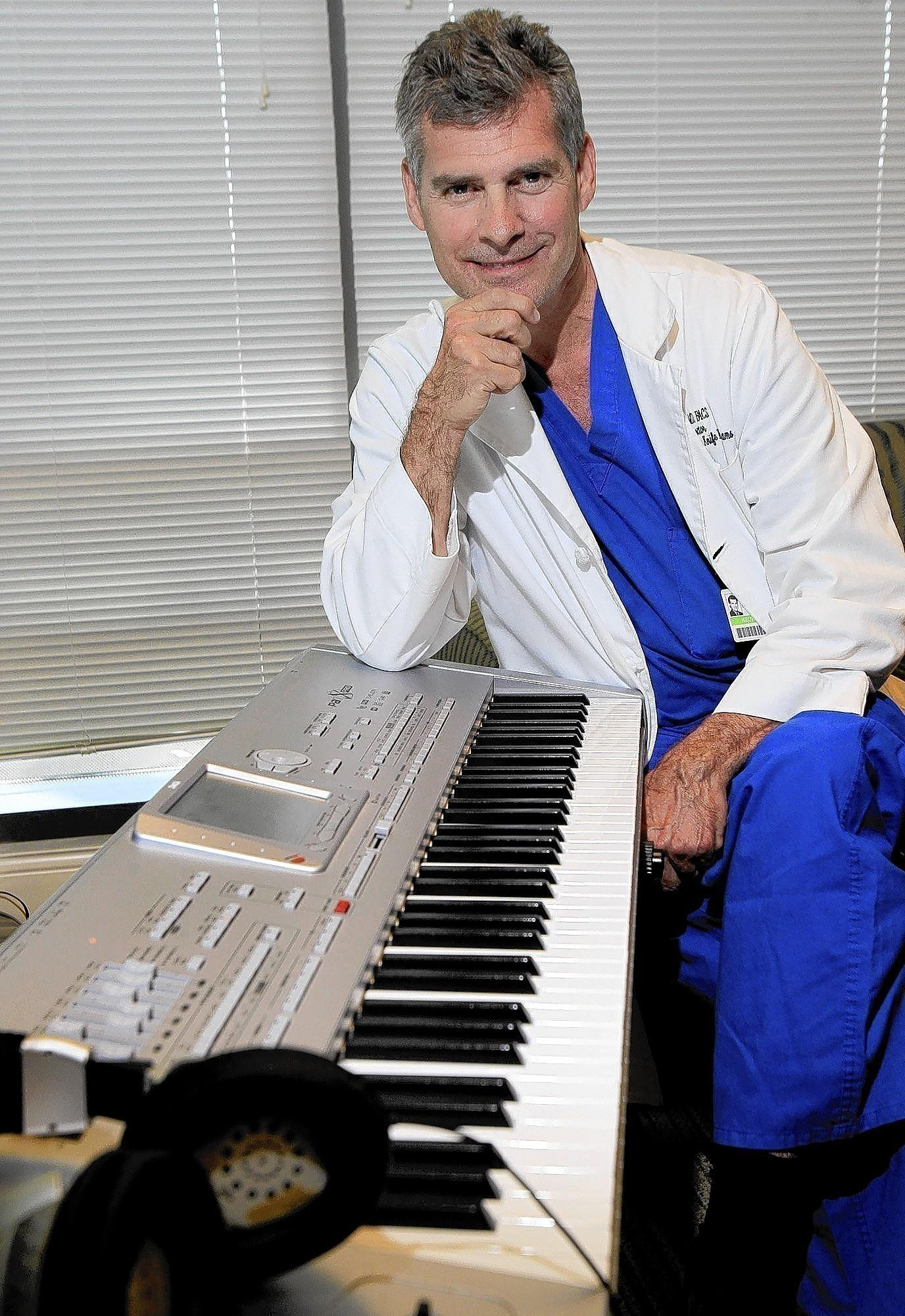 "Dr. Christopher Duma in his office at Hoag Neuroscience Institute in Newport Beach. Duma has recently been working on ""Symphonic Suite for Healing"" with American pianist and composer Mike Garson. ""Symphonic Suite for Healing"" is music used for patients living with various disorders and ailments to treat the human mind, body and soul."