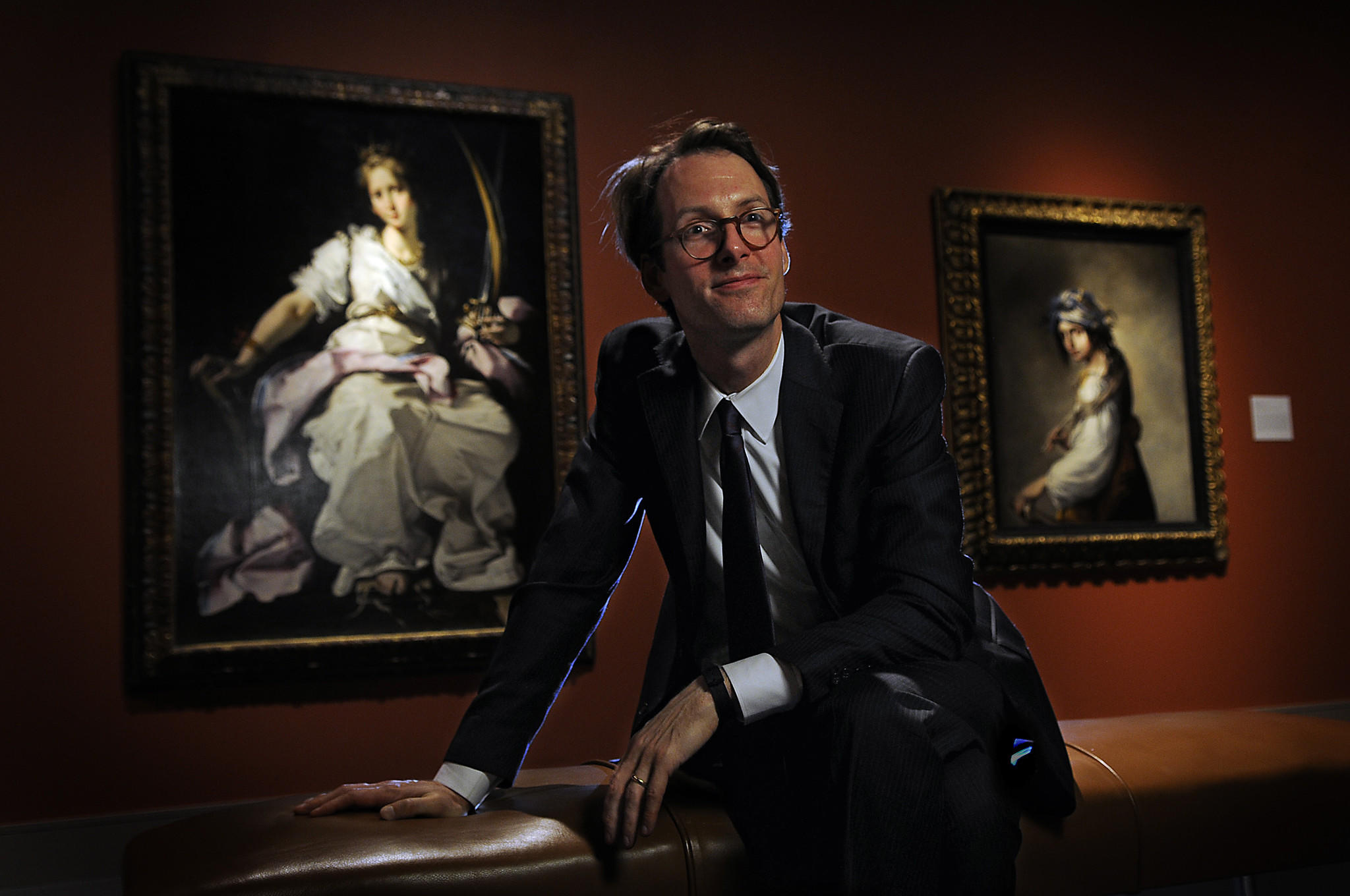 Oliver Tostmann is the new Fine European arts curator at the Wadsworth Atheneum. Tostmann is seated between Bernardo Strozzi's Saint Catherine of Alexandria, 1615, and Salvator Rosa's Lucrezia As Poetry, 1641.