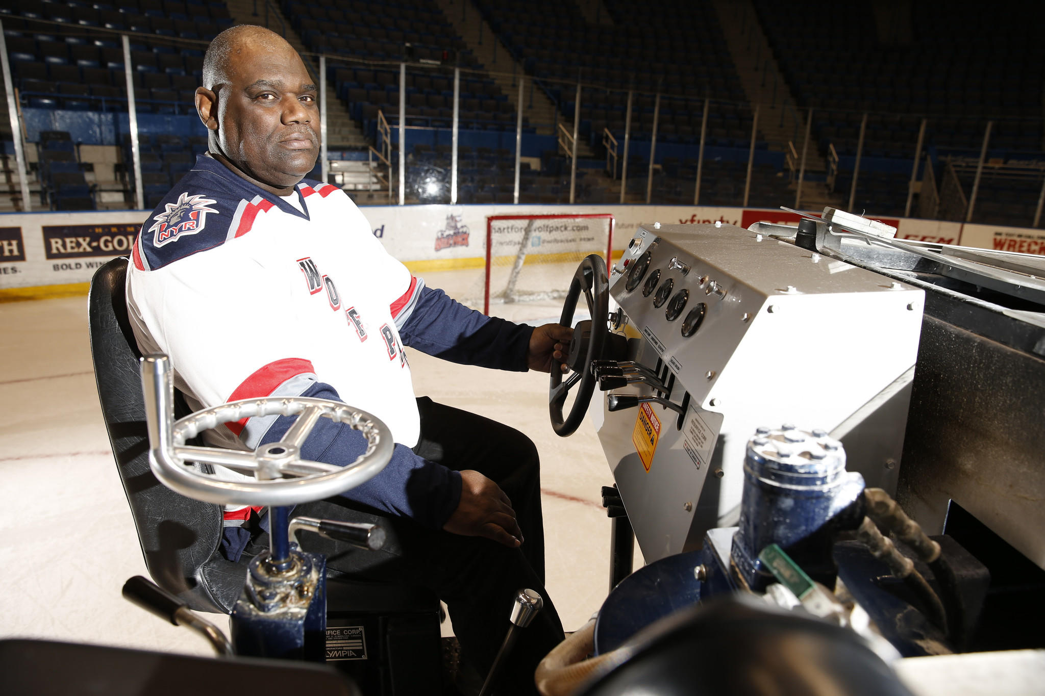 "Zamboni Driver Therell Wayne ""Scoop"" Knight poses for a picture at the XL Center. Knight has been behind the wheel of the Civic Centers Zamboni for some 35 years."