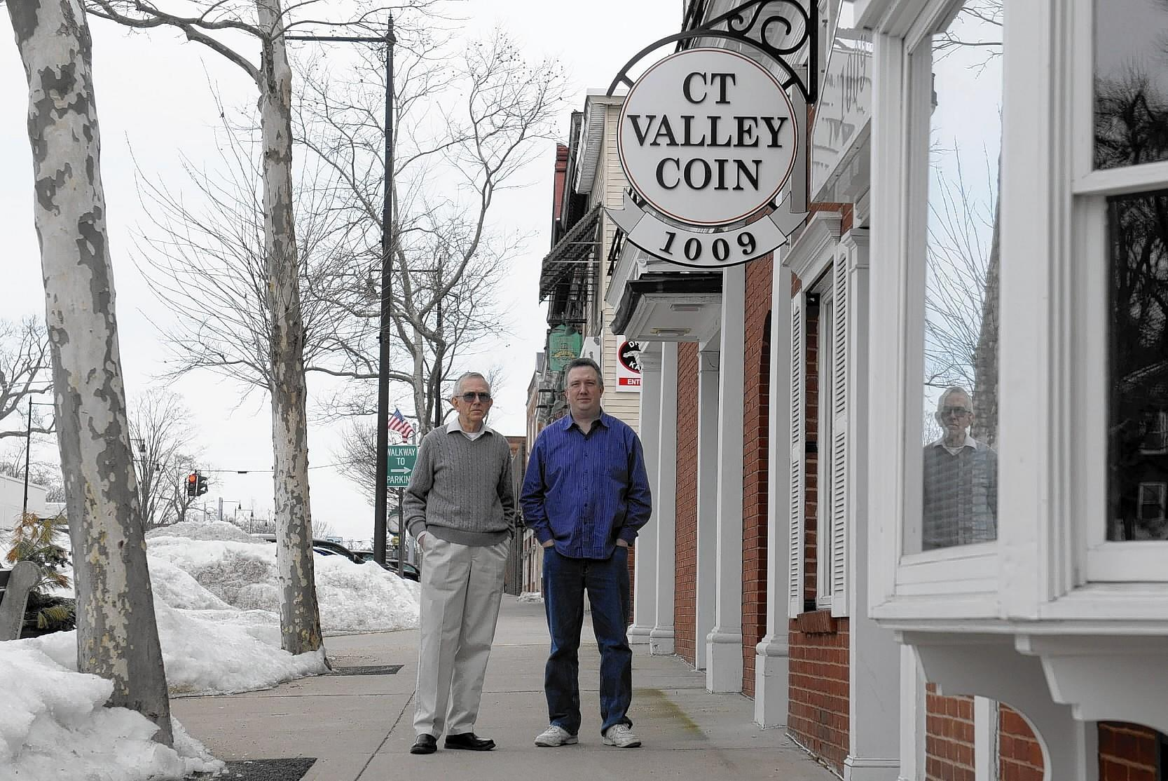 John Muller, left, and his son David Muller are now just getting back on their feet after a fire distroyed their business, Connecticut Vally Coin in Manchester in October last year. The pawnbrokers and coin dealers will be open for new customers in April at their new location on Main Street in Manchester.