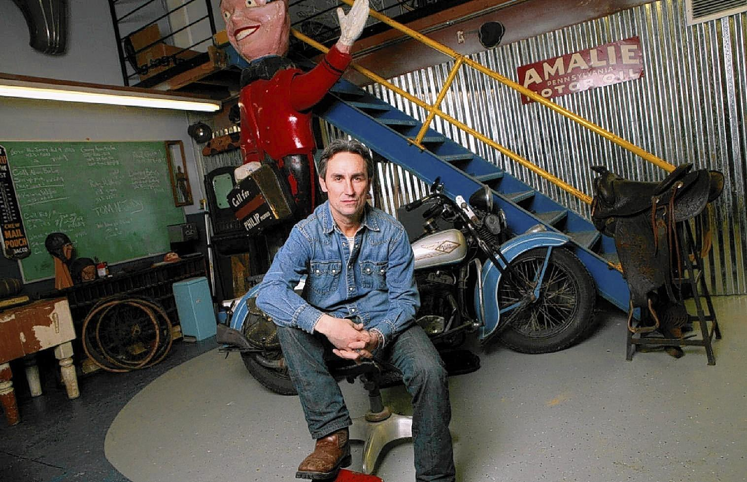"""Mike Wolfe of """"American Pickers"""" fame poses inside his original antique shop in LeClaire, Iowa. (Mike Wolfe photo)"""