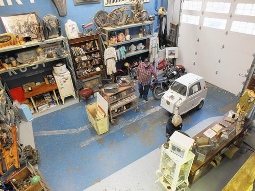 A customer wanders through the eclectic collection of items for sale at Antique Archaeology in LeClaire.